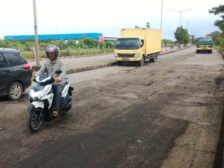 10225 medium perbaikan jl marunda raya diminta dilakukan secara permanen