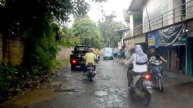 37207 medium depok musim hujan