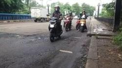 51266 small jalan grand depok city rusak parah