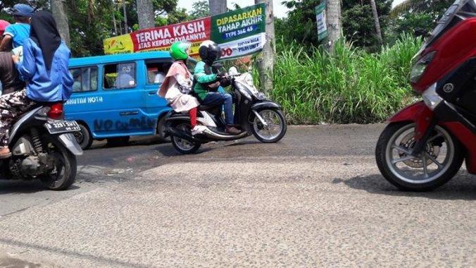 63110 medium jalan raya bambu kuning bogor masih berhias lubang